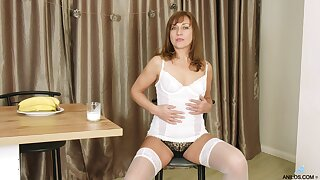 Sex-appeal older woman Rafaella shows striptease with the addition of plays with pussy