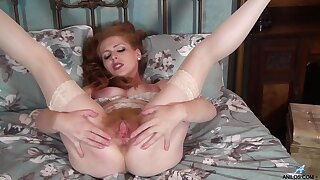 Beloved redhead chick Tia Jones drops her uninspired panties to play