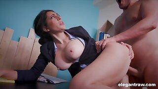 Secretary Eloa Lombard with big fake boobs rides a big pecker