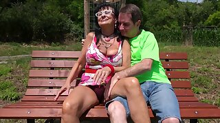Outdoors FFM threesome with an older span with an increment of a cute stranger