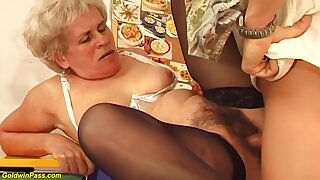 Hairy Hungarian granny is sucking a much younger guys learn of and getting fucked hard, in return